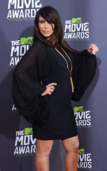 Kim Kardashian arrives at 2013 MTV Movie Awards in Culver City, California