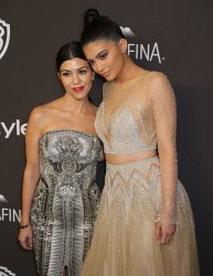Kourtney Kardashian and Kylie Jenner attend the InStyle and Warner Bros. Golden Globe after-party in Beverly Hills