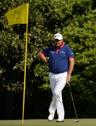 Shane Lowry hits a tee shot at the Masters