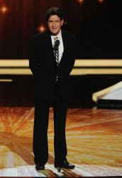 Charlie Sheen presents an award at the 63rd annual Primetime Emmy Awards in Los Angeles