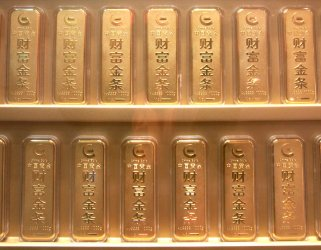 Small gold bullion bars are sold in Beijing