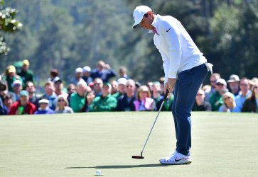 Rory McIlroy makes a putt for par at the Masters