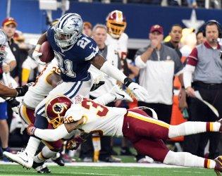 Dallas Cowboys and Washington Redskins play on Thanksgiving Day in Arlington, Texas