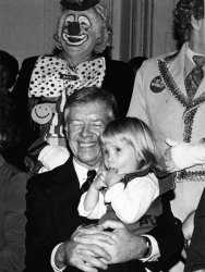 Jimmy Carter holds granddaughter at Christmas party