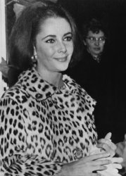 Elizabeth Taylor smiles upon learning that her divorce from Eddie Fisher had been granted