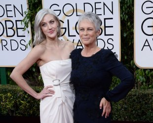 Annie Guest and Jamie Lee Curtis attend the 73rd annual Golden Globe Awards