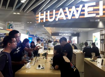 Chinese check out the latest Huawei products in Beijing, China