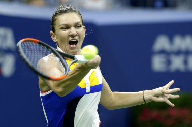 Simona Halep of Romania hits a forehand at the US Open