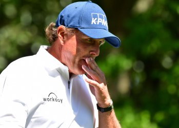 Phil Mickelson walks to the fairway at the Masters