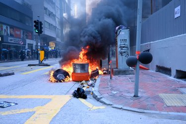 Fire Burns on a Hong Kong Street During Protest