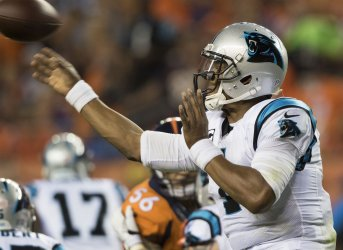 Panthers QB Newton hurries throw in Denver