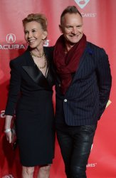 Trudie Styler and musician Sting  arrive at 2013 MusiCares Person of the Year gala in Los Angeles