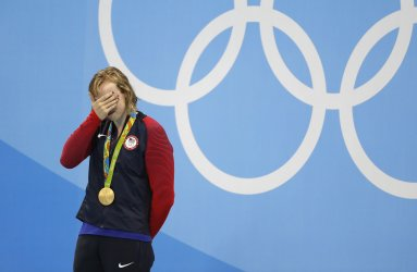 Katie Ledecky (USA) reacts after receiving the gold medal for a record 8:04.79 in the Women's 800M Freestyle at the 2016 Rio Olympics