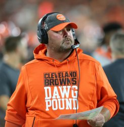 Browns head coach Kitchens on sidelines against Rams