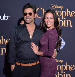 "John Stamos and Caitlin McHugh attend the ""Christopher Robin"" premiere in Burbank, California"