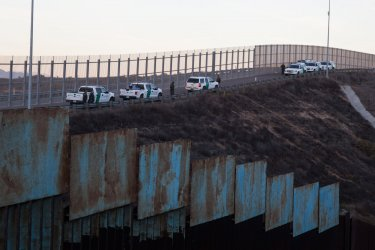 Asylum Seekers Jump Border Fence