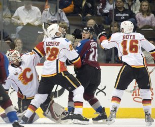 Flames Kiprusoff, Regehr, and Boyd watch for Puck Against Avalanche Stastny in Denver