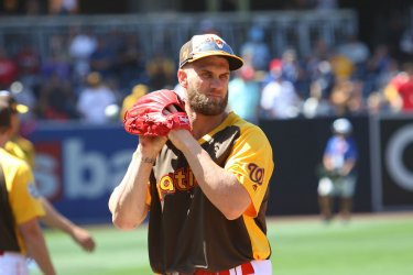 National League's Bryce Harper warms up in San Diego