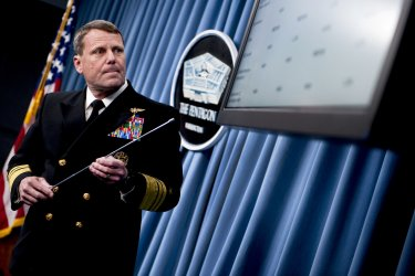 """Navy Vice Adm. William E. Gortney, director of the Joint Staff, briefs the press on """"Operation Odyssey Dawn"""" in Washington"""