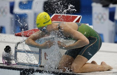 Australia's McKeon wins Women's 50m Freestyle Final with Olympic record of 23.81