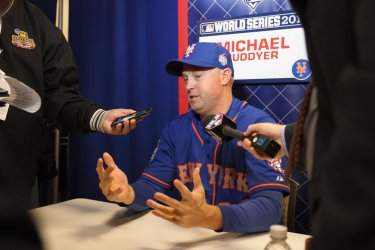 Mets' Michael Cuddyer speaks to the media prior to the World Series