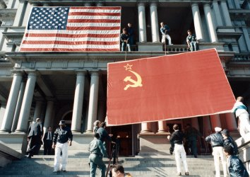 Workers prepare to hang a large Soviet flag to welcome Gorbachev