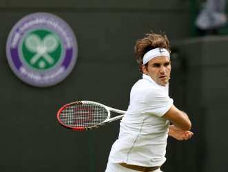 Roger Federer returns in the first round at 2012 Wimbledon Tennis Championships