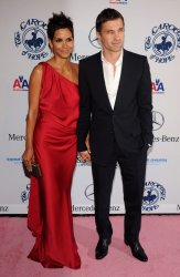Actress Halle Berry and Olivier Martinez  attend the 32nd anniversary Carousel of Hope Ball in Beverly Hills