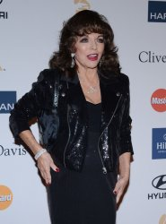 Joan Collins attends the Clive Davis pre-Grammy party in Beverly Hills, California
