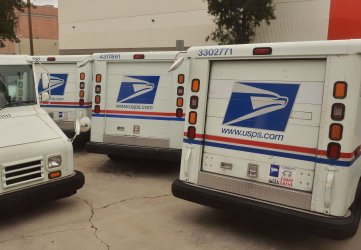 USPS delivery trucks at vehicle maintence facility in Los Angeles