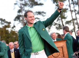 Danny Willett gives a thumbs up wearing his Green Jacket