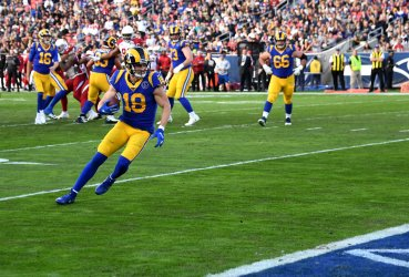 Rams Cooper Kupp scores during the second quarter against the Cardinals at the Coliseum in Los Angeles
