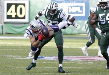 New England Patriots Julian Edelman gets tackled
