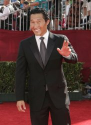Daniel Kim arrives at the 61st Primetime Emmy Awards in Los Angeles