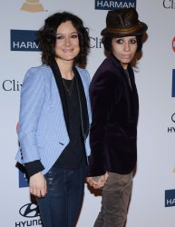 Actress Sara Gilbert and musician Linda Perry attend the Clive Davis pre-Grammy party in Beverly Hills, California