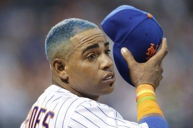 New York Mets Yoenis Cespedes holds his cap