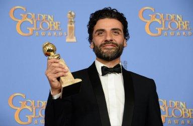 Oscar Isaac wins an award at the 73rd annual Golden Globe Awards in Beverly Hills