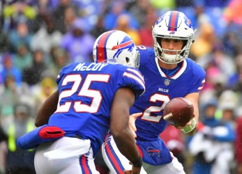 Bills running back LeSean McCoy is given the ball