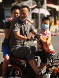 Chinese Continue to Wear Face Masks in Beijing, China