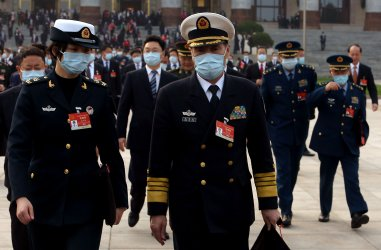 Military Delegates Leave the NPC in Beijing, China