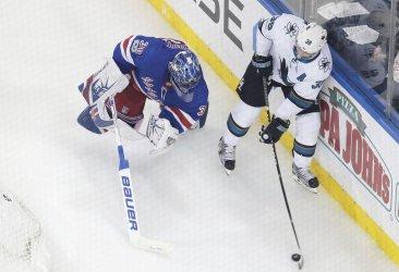 Rangers goalie Henrik Lundqvist goes behind the net