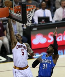 Cavaliers J.R. Smith shoots past Orlando Magic defender Terrence Ross