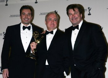 Jimmy Fallon, Lorne Michaels and Alec Baldwin arrive in the press room for the 38th International Emmy Awards in New York