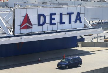 A Delta Airlines sign hangs at a terminal at LaGuardia Airport