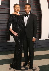Chrissy Teigen and John Legend arrive at the Vanity Fair Oscar Party in Beverly Hills