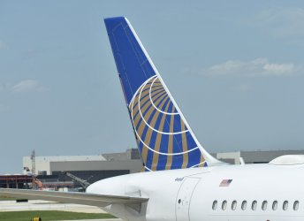 United Planes Stand at Gates at O'Hare Airport in Chicago