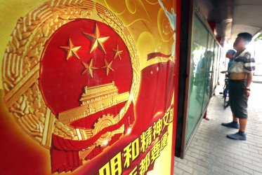 Chinese read government controlled newspapers in Beijing