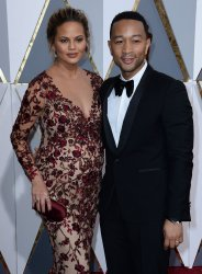 Chrissy Teigen and John Legend arrive for the 88th Academy Awards in Hollywood