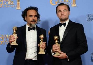Alejandro Gonzalez Inarritu and Leonardo DiCaprio win an award at the 73rd annual Golden Globe Awards in Beverly Hills