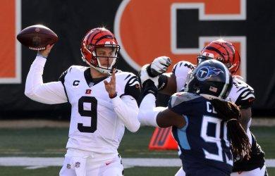 Bengals Joe Burrow Throws under Pressure from Titans' Jadeveon Clowney